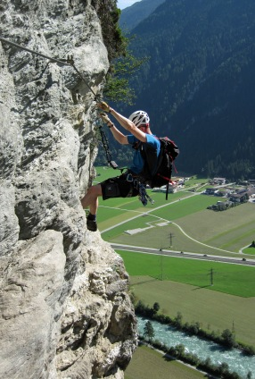 Me climbing back along the traverse that leads to the bell on the Klettersteig Pfeilspitzwand.