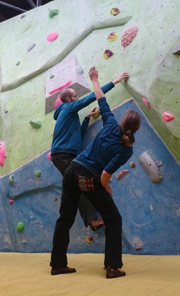 Alice coaching me on how to climb using the open hand technique.