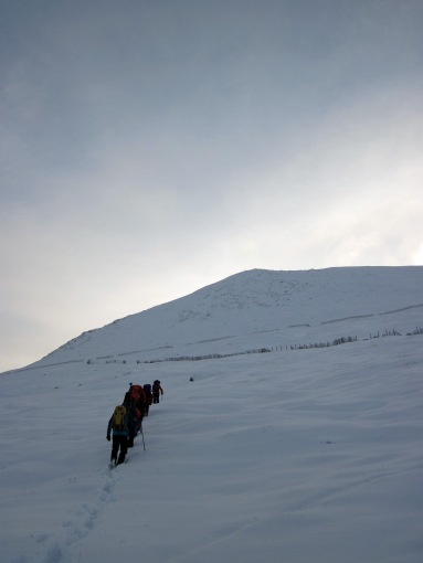 The group walking up Aonach an Nid.