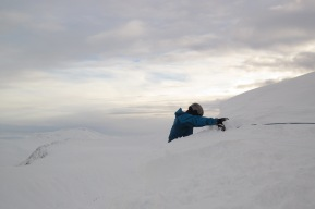 Having kicked a lump of cornice off, I'm now descending the edge while being belayed by Bill.