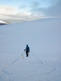 Me practising abseiling off a snow bollard I had made.