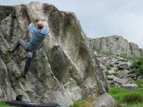Me bouldering on the Marsh Boulder at the RAC Boulders.