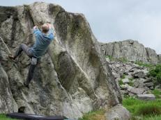 Me bouldering on the Marsh Boulder at the RAC Boulders.