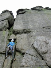 Me leading Hollybush Gully Right Direct (Severe, 4a) at Stanage.