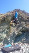 Bouldering above the beach of Lon Isallt Bay.