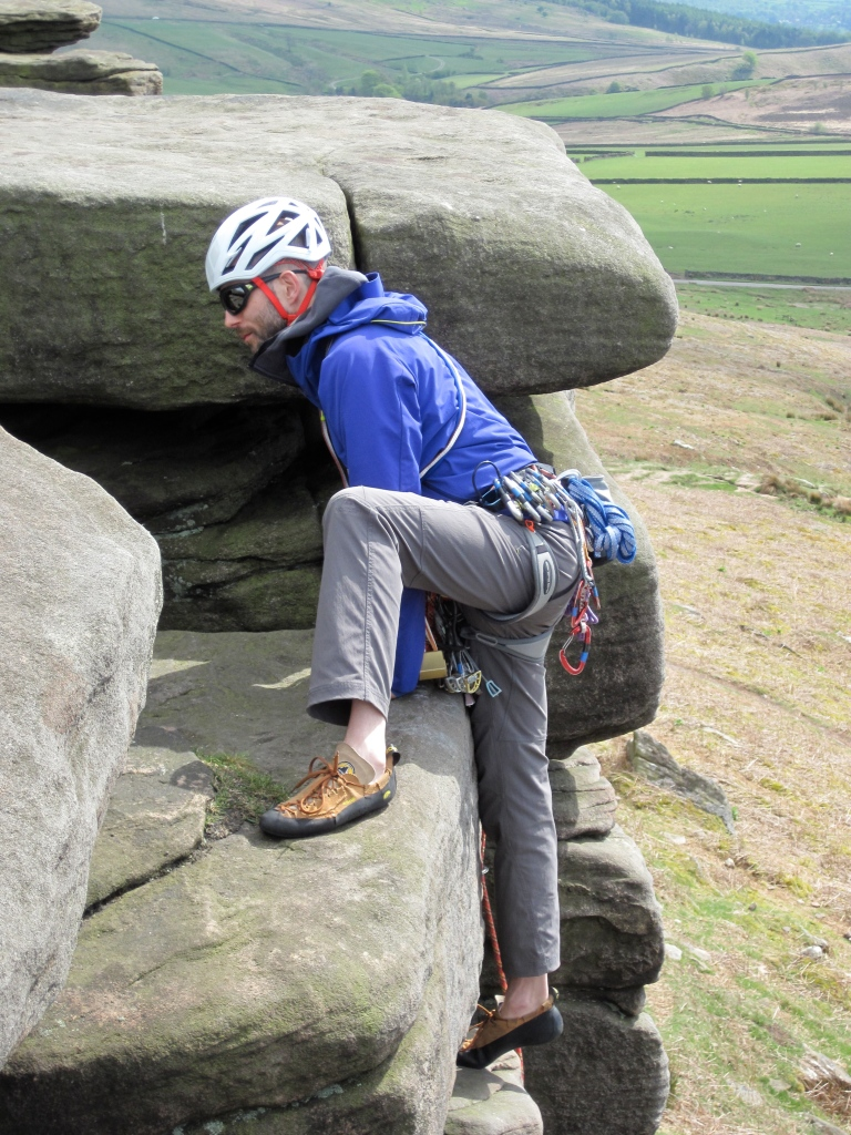 Me climbing at Stanage in the Black Diamond Vapor Helmet.