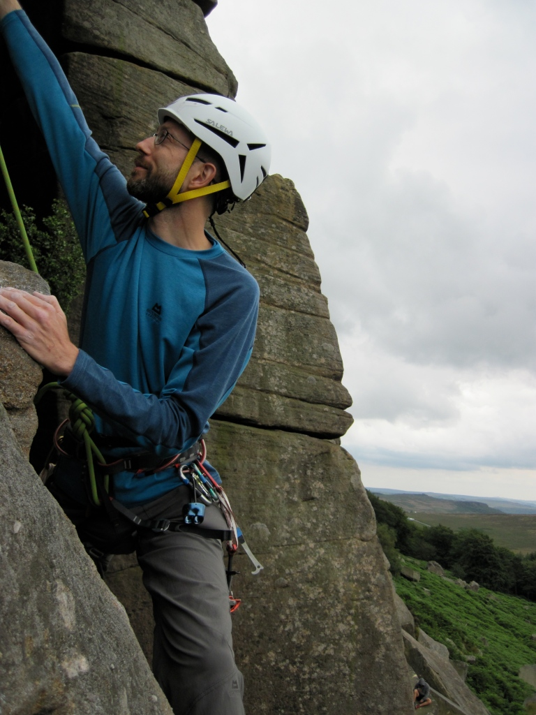 Me climbing at Stanage in the Salewa Vega helmet.