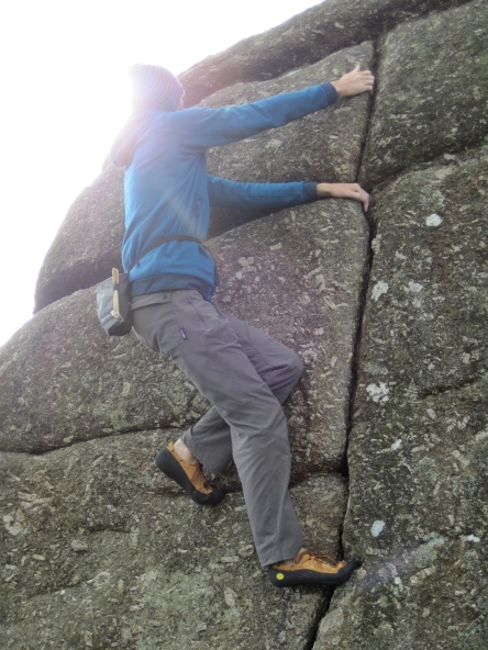 The sun managing to stay out as I climb on the Warm-Up boulder at Bonehill.