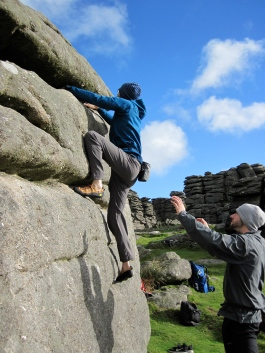 Me climbing on The Perched Block at Hound Tor on Dartmoor..