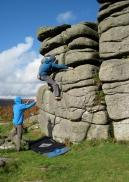 Me climbing boulder problem The Runnel (3+) at Hound Tor.