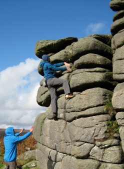 Me climbing The Runnel problem at Hound Tor.