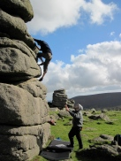 Leo climbing The Runnel on the Top Hat boulder at Hound Tor.