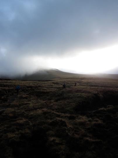 The sun broke through the cloud as I walked along a ridge towards the summit of Corn Du.