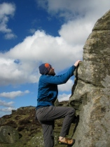 Climbing the brilliantly fun problem Front On (V0- 4a) in the Little Quarry at Curbar Edge.