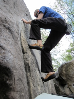 Me trying to do the crimping and smearing start of problem 7 on the orange circuit at Roche aux Sabots. This photo was taken by my 3 year old son.