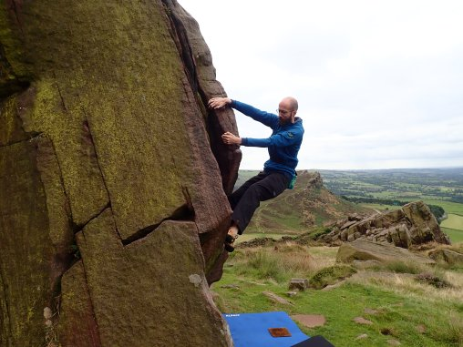 Me trying to climb Easy Groove (V0 4c) on The Grooves boulder at the Roaches. Seconds after this photo was taken my left foot slipped and I flew off the rock.