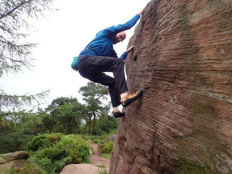 Climbing Joe's Portholes (V0+ 5a) on Joe's Boulder at the Roaches.