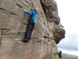 Me climbing the fun problem Slab Dancer (V0+ 5a) on the Upper Tier of the Roaches. The problems along here involve stopping and coming back down again before the climb turns from being a boulder problem into a solo rock climb.