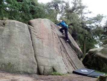 Me reaching the top of the Arch (V0+ 5a) problem on Pine Tree Slab on the Lower Tier of the Roaches.