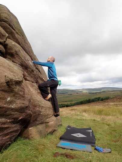 Climbing Easy Slab Right-hand (VB) on the Top Block boulder at Newstones.