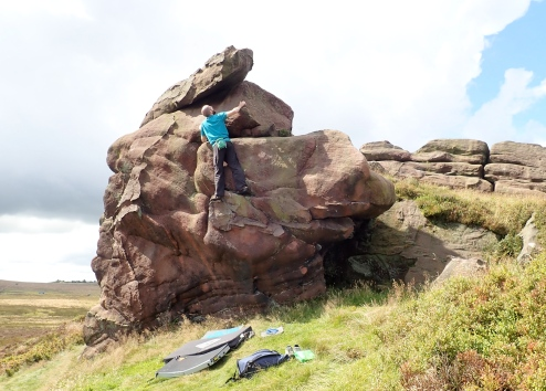 This is me trying to work out the best way of getting from the good footholds I'm standing on to the good hand holds at the top. The problem is Nutmeg (V0 4c) on the Hazel Barn boulder at Newstones.