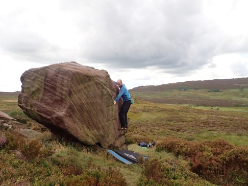 Me climbing Clammy Wall (V0 4c) on the Clammy Hands boulder at Newstones.