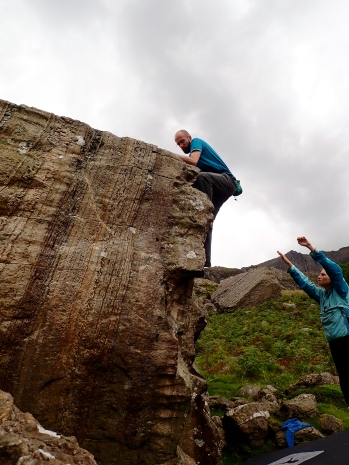 Me climbing an unnamed 4C problem on the Wavelength Boulder in Llanberis Pass, while Katrina spots me.