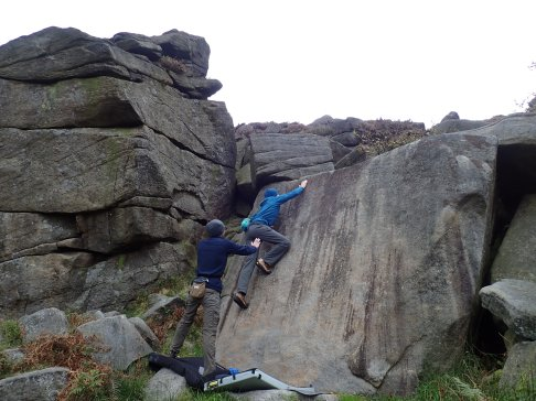 Me climbing Tiny Slab Left (V1 5b) on The Tiny Slab at Burbage North.