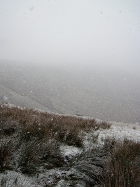 Snow falling on the tops above the Vale of Edale in the Peak District.