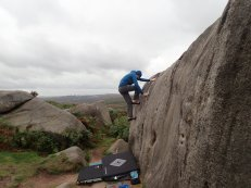 Climbing Peasy Flake (VB) on The Useful Boulder at Burbage South Valley.