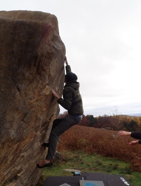 Trying unsuccessfully to do a dyno on the problem Steep Side (V0+ 5a) on the Lone Boulder at Stanage Plantation.