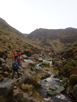 Walking up Grindsbrook Clough to get onto a windy Kinder Scout.