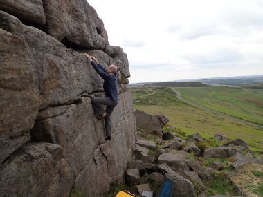 Climbing the Gripple One problem at Stanage Far Right