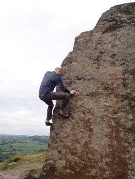 Climbing Fishy (V0 4c) in the Little Quarry at Curbar Edge.