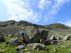Climbing an unnamed problem on the Jacko Boulder at Settle Earth Boulders, in Longsleddale.