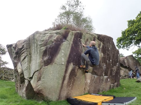 Climbing an unnamed boulder problem on the Bottom Block at the Langdale Boulders.