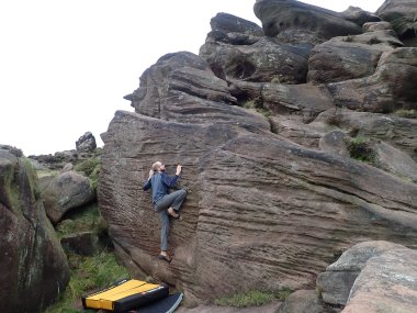 Trying to climb Cellar Slab 2 (V2 5c) in The Cellar area of The Roaches.