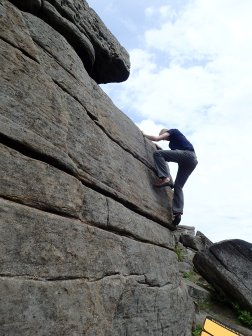 Climbing the problem Tweedle Dum (VB 4a) at Stanage Far Right.
