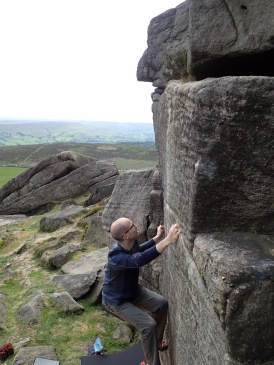 Trying to climb Gribble Nipple (V1 5b) at Stanage Far Right.
