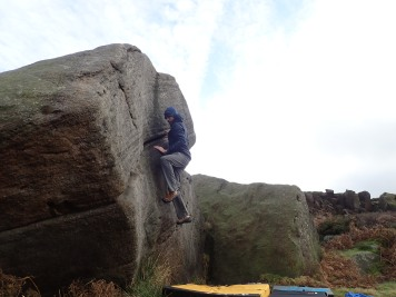 Trying again (and failing again) to climb the problem Right Whale (V0 4c) on The Whale boulder at Burbage South Valley.