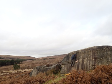 Climbing Kidney Wall (V0+ 5a) on The Kidney boulder at Burbage South Valley.