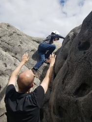Leo climbing up a Font 2 problem on the back of the Dumbo the Elephant boulder. Copyright: Valerie Van den Hende
